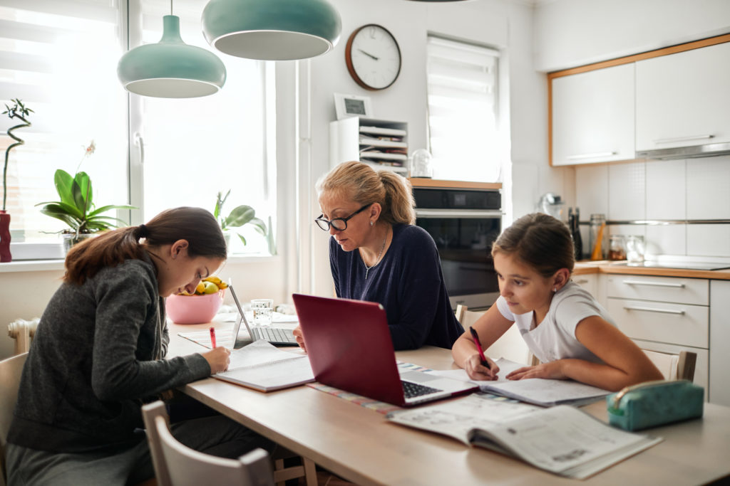 family working at kitchen table
